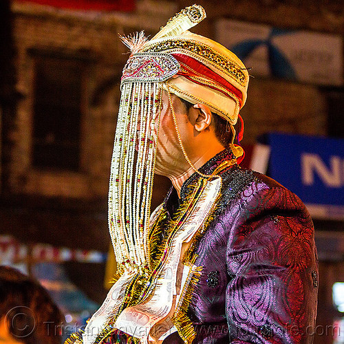 indian groom with fringes hat at his wedding (india), bank notes, costume, embroidery, fly fringes, fringes veil, headdress, man, money, night, people, rishikesh