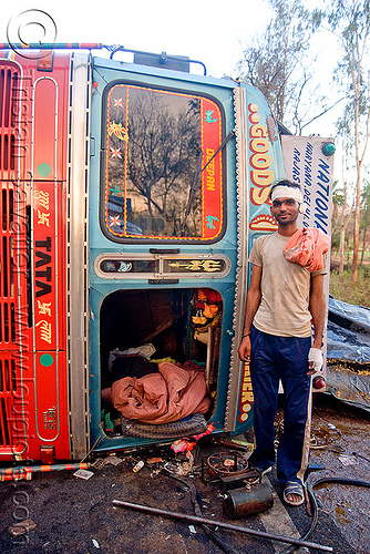 indian truck driver and his overturned truck - accident (india), cab, cabin, crash, lorry, man, overturned truck, road, rollover, standing, swastika, tata motors, traffic accident, truck accident, truck driver, trucker, wreck