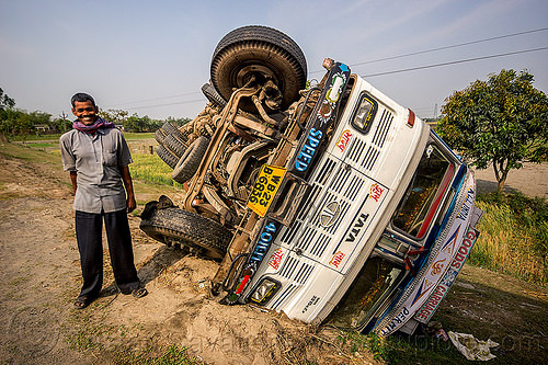 indian truck driver - overturned truck - TATA motors (india), crash, ditch, lorry, man, overturned, road, rollover, standing, tata motors, traffic accident, truck accident, truck driver, trucker, twisted, up-side-down, west bengal, wreck