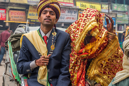 indian wedding - proud groom holding his covered bride like a trophy, bindi, bride, dressed-up, groom, hand mehndi, headdress, india, indian wedding, man, scarf, standing, suit, tilak, traditional, turban, varanasi, woman