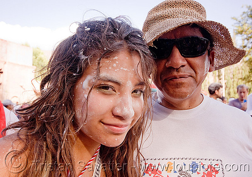 indigenous quechua father and daughter at the carnaval de tilcara (argentina), andean carnival, carnaval, daughter, father, man, noroeste argentino, quebrada de humahuaca, quechua, tilcara, woman
