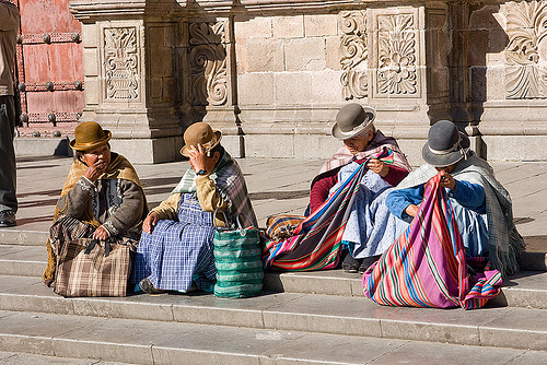 indigenous women sitting on stairs - la paz (bolivia), bowler hats, iglesia de san francisco, iglesia san francisco, people, plaza san francisco, quechua, san francisco church, steps, street