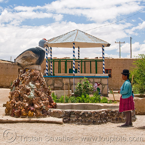 indigenous woman and bird monument (bolivia), alota, bolivia, bowler hat, indigenous, monument, quechua, village, woman