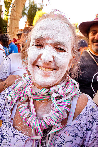 indigenous woman with white talk powder and serpentine throws - carnaval de tilcara (argentina), andean carnival, argentina, confettis, noroeste argentino, quebrada de humahuaca, serpentine throws, talk powder, tilcara, woman