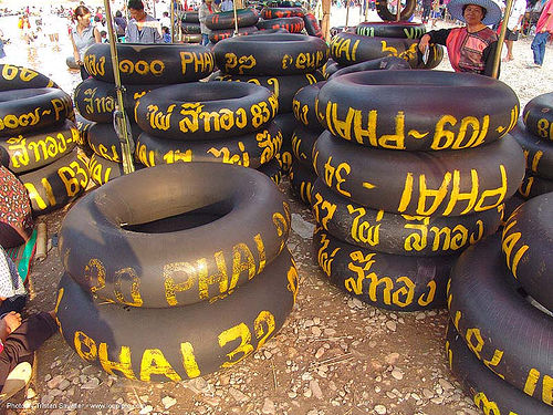 inner tubes with yellow paint markings - river tubing - thailand, fang, festival, inner tubes, river fair, river tubing, songkran, tha ton, ประเทศไทย, สงกรานต์