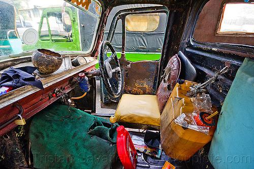 bemo cabin, autorickshaw, becak, bemo, cab, cabin, daihatsu midget, fuel, gas can, gasoline, interior, jakarta, java, jerrycan, midget i, motor oil, petrol, plastic can, rickshaw, seat, steering wheel, street, three wheeler