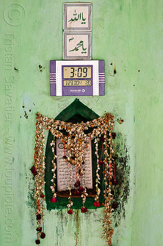 islamic shrine with LCD clock, altar, arabic, british residency, digital clock, flower strings, flowers, green wall, imambara, islam, lcd clock, lucknow, mosque, nawabi mahal, nawabi masjid, tiles, time, urdu script, urdu writing, wall clock
