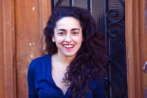 italian girl smiling, brunette, curly hair, dilve, door window, house door, ironworks, italian woman, long hair, paris, red lipstick