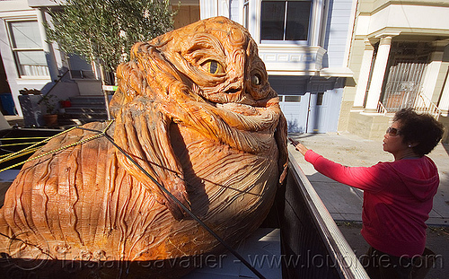 jabba the hutt in a pickup truck, character, giant muppet, jabba the hutt, pickup truck, ropes, special effects, starwars, street, woman