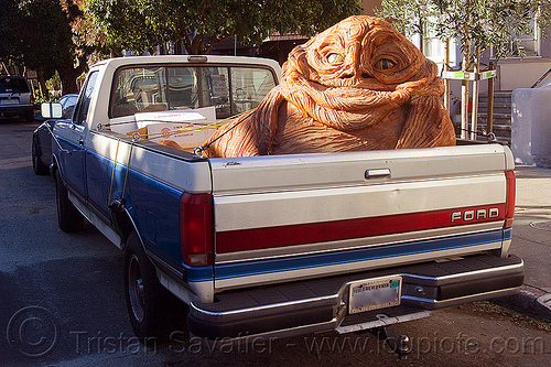jabba the hutt in a pickup truck, character, giant muppet, jabba the hutt, pickup truck, special effects, starwars, street