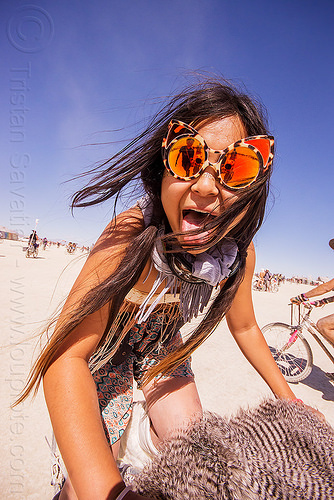 japanese girl with tiger orange mirror sunglasses - burning man 2015, burning man, mirror sunglasses, nicole, sticking out tongue, sticking tongue out, tiger sunglasses, woman