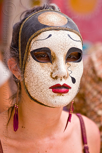 japanese mask, asian woman, burning man, center camp, cracked, japanese mask