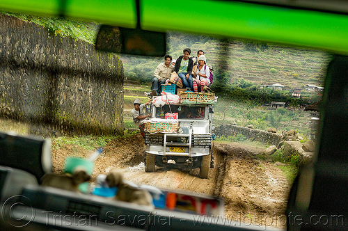 jeepney on muddy road with passengers on roof (philippines), cordillera, dirt road, jeepney, mud, muddy, passengers, philippines, public transportation, roof, sitting