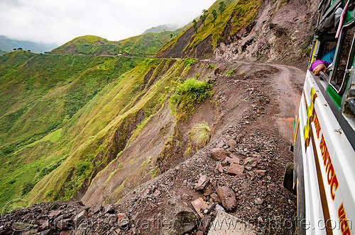 jeepney on precarious dirt road on steep mountain slope (philippines), chico valley, cordillera, dirt road, jeepney, mountains, philippines, public transportation, steep