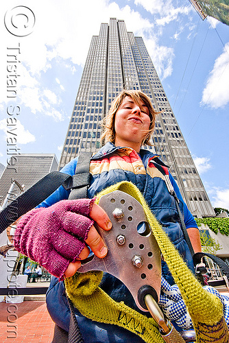 jessika is geared-up with harness and trolley - zip-line over san francisco, adventure, building, embarcadero, embarcadero center, extreme sport, gear, high-rise, justin herman plaza, mountaineering, people, sling, strap, tower, tyrolienne, urban, woman, zip line, zip wire, ziptrek