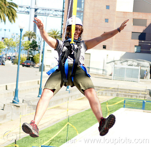 jessika riding the zipline (san francisco), adventure, cable line, climbing helmet, embarcadero, extreme sport, gear, hanging, harness, jessika, justin herman plaza, mountaineering, tyrolienne, urban, woman, zip line, zip wire, ziptrek
