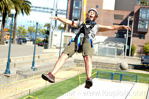 jessika riding the zipline (san francisco), adventure, climbing helmet, embarcadero, extreme sport, gear, hanging, harness, jessika, justin herman plaza, mountaineering, tyrolienne, urban, woman, zip line, zip wire, ziptrek