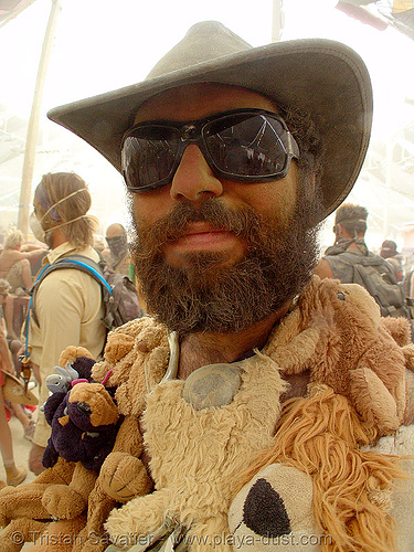 jon surdo surviving the dust storm in center camp - burning man 2007, burning man, center camp, dust storm, hat, jon surdo, sunglasses, teddy bears