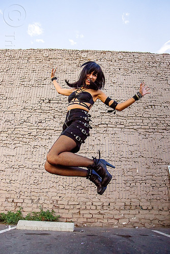 jumping girl - folsom street fair 2015 (san francisco), brick wall, buckles, folsom street fair, high heel, jump, jumpshot, woman