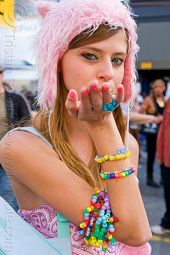 kandi girl blowing a kiss, beads, blowing a kiss, bracelets, brianna, how weird festival, kandi kid, kandi raver, pink fuzzy hat, plur, rave fashion, woman