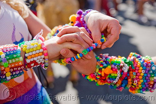 kandi kids swapping bracelets, arms, beads, bracelets, clothing, fashion, festival, hands, handshake, kandi cuffs, kandi kid, kandi raver, love fest, lovevolution, passing, plur, swapping, wrists