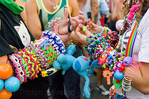 swapping kandi, arms, clothing, hands, harm, kandi cuffs, kandi kid, man, party, plur, woman, wrists