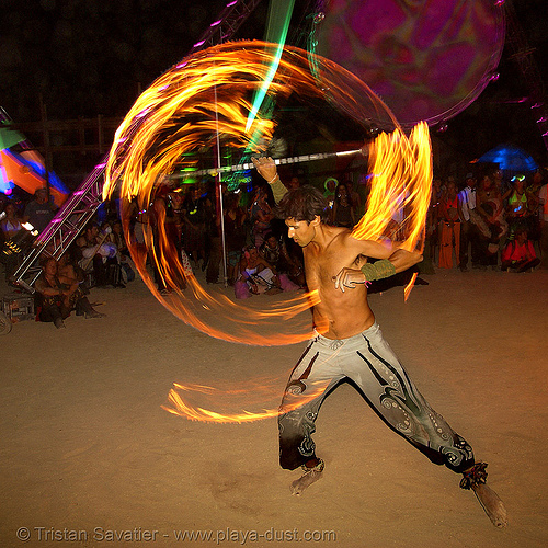 keith aka srikanta spinning a fire staff - burning man 2007, dancer, fire dancer, fire dancing, fire performer, fire spinning, flames, long exposure, night, people, spinning fire, srikant