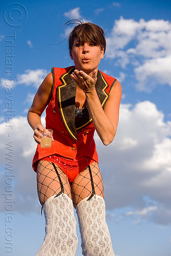 kelley on stilts - burning man 2009, blow a kiss, blowing a kiss, circus metropolus, costume, people, stilts performer, stiltwalker, stiltwalking, woman