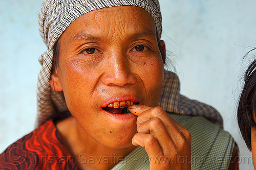khasi woman chewing betel nut quids (india), areca nut, betel leaf, betel nut, betel quids, betelnut teeth, east khasi hills, india, indigenous, mawlynnong, meghalaya, woman