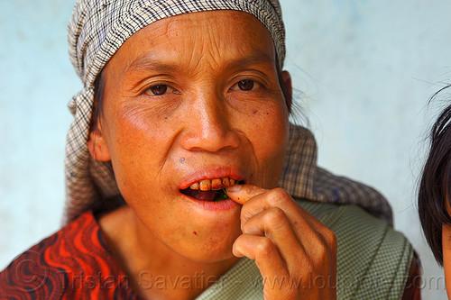 khasi woman chewing betel nut quids (india), areca nut, betel nut, betel quids, east khasi hills, indigenous, mawlynnong, meghalaya, woman