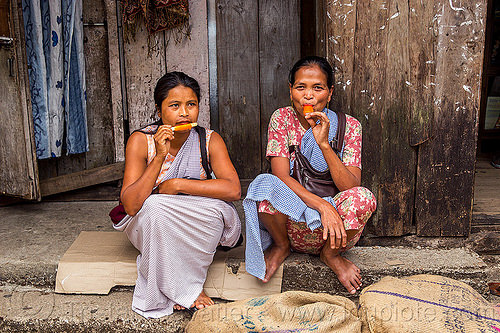 khasi women eating ice pops (india), east khasi hills, ice candy, ice pops, indigenous, italian ice, meghalaya, popsicles, pynursla, sitting, water ice, women