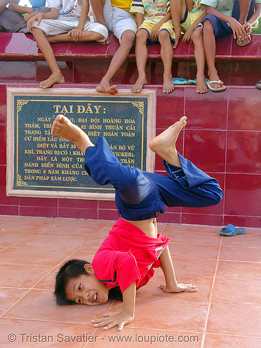 kid break-dancing - vietnam, boys, break dance, break dancing, children, communism, kids, memorial, monument, phan thiet, victory, vietnam