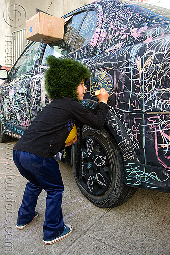 kid chalk writing on car - burning man decompression 2009 (san francisco), black car, burning man decompression, chalk writing, child, graffiti, kid, street art, vandalism