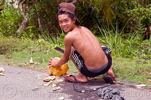 kid cutting coconut, coco, coconut, cutting, kid, knife, machete, man, road, squatting