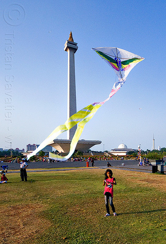 kid flying a kite near the national monument (monas) in jakarta, architecture, child, column, eid ul-fitr, flying, girl, jakarta, java, kid, kite, medan merdeka, merdeka square, monas, monumen nasional, national monument, park, turf
