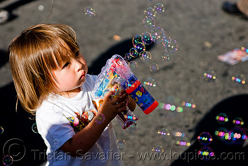 kid making soap bubbles with bubble gun, boy, bubble gun, darius, haight street fair, kid, people, playing, small, soap bubbles, toddler, toy gun, young child