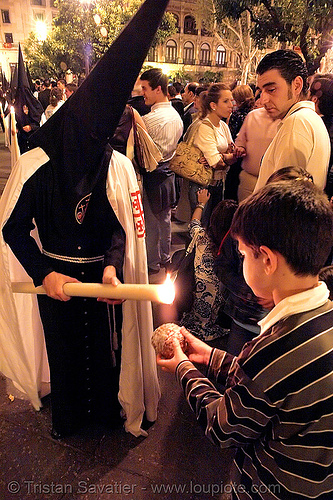 kid making wax ball, andalucía, candles, capirotes, child, cofradía, easter, el museo, hermandad del museo, kid, nazarenos, night, parade, procesión, procession, religion, semana santa, sevilla, wax ball