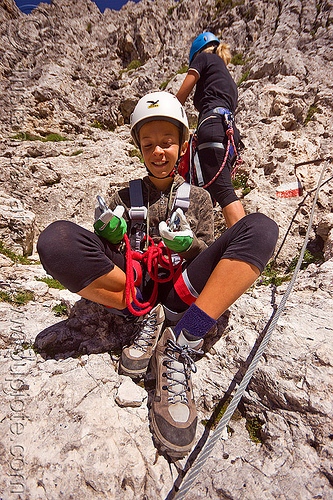 kid with climbing gear, alps, climbers, climbing harness, climbing helmet, dolomites, dolomiti, girl, hiking boots, mona, mountain climbing, mountaineer, mountaineering, mountains, rock climbing, steel cable, teen, teenager, via ferrata