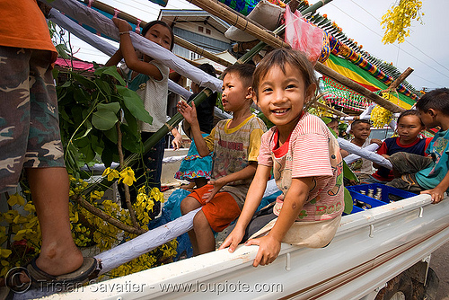 kids in pickup truck - parading the giant bamboo fireworks rocket - vang vieng (laos), bamboo rocket, child, festival, fireworks, giant, kid, parade, pyrotechnics, vang vieng