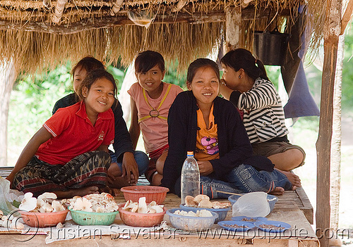 kids playing on market stand (laos)