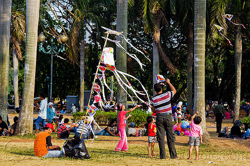 kite merchant, children, eid ul-fitr, flying, jakarta, java, kids, kites, medan merdeka, men, merchant, merdeka square, park, pole, rubans, streamers, street vendor, trees, turf