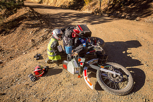 KLR 650 motorbike crash on dirt road, accident, california, crash, dirt road, dropped, dual-sport, eastern sierra, helmets, kawasaki, klr 650, luggage, lying down, mishap, motorcycle touring, panniers, rack, tank bags, woman