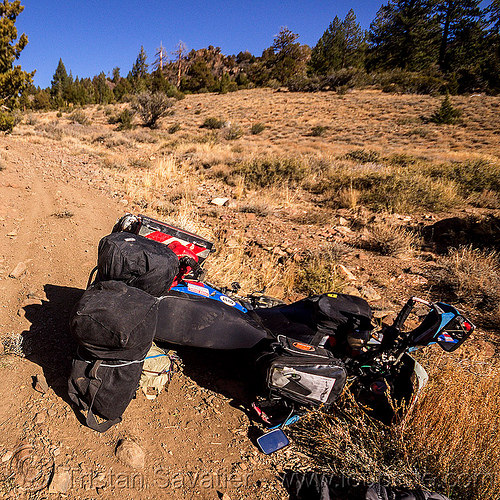 KLR 650 motorbike crash on dirt trail, accident, california, crash, dirt road, dropped, dual-sport, eastern sierra, kawasaki, klr 650, luggage, lying down, mishap, motorbike touring, motorcycle touring, panniers, rack, tank bags