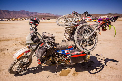 KLR 650 motorcycle in the desert - burning man 2015, bicycle, bike, burning man, dual-sport, duffle bags, helmet, kawasaki, klr 650, luggage, motorbike touring, motorcycle touring, overloaded, panniers, tank bag