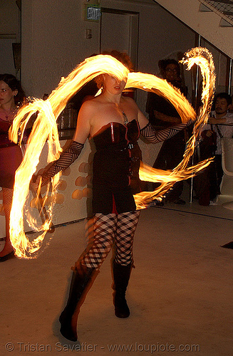 krissy spinning fire staffs (san francisco), double staff, fire dancer, fire dancing, fire performer, fire spinning, fire staves, flames, long exposure, night, people