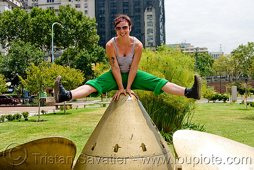 krista  playing on a giant ship propeller (buenos aires), boat propeller, large boat propeller, large ship propeller, marine, monument, people, puerto madero, woman