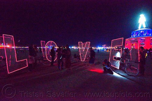 L.O.V.E bicycles - burning man 2012, art, bicycles, bikes, el-wire, glowing, letters, love, night