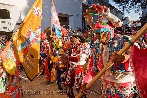 """la comparsa """"los picaflores"""" - carnaval de humahuaca (argentina), andean carnival, comparsa, costume, diablo carnavalero, diablo de carnaval, flag, folklore, horns, indigenous culture, los picaflores, man, mask, mirrors, noroeste argentino, quebrada de humahuaca, tribal"""