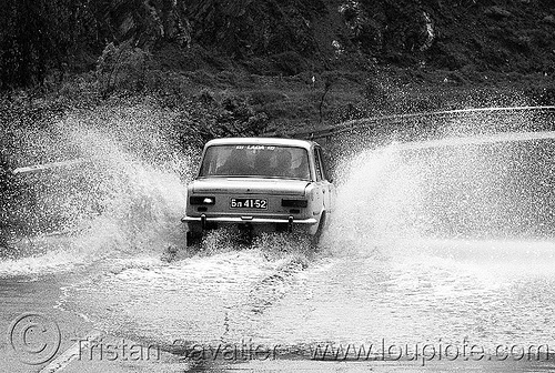 lada - car splashing water on road (bulgaria), flooded, puddle