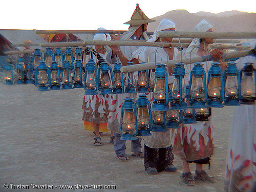 lamplighters - burning-man 2005, burning man, lamplighters, march, petrol lanterns, poles